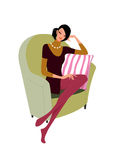 Beautiful woman sit on a sofa Stock Images