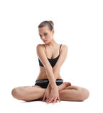 Beautiful woman sit in yoga asana isolated Stock Image