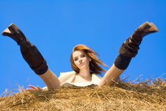Beautiful woman siting on haystack Royalty Free Stock Image
