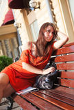 Beautiful woman sits on bench Royalty Free Stock Photography