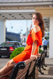 Beautiful woman sits on bench royalty free stock images