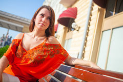 Beautiful woman sits on bench royalty free stock photos