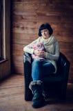 Beautiful woman sitting in an armchair Stock Photos