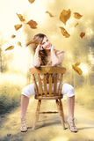 Beautiful woman sitting in autumn field Stock Images