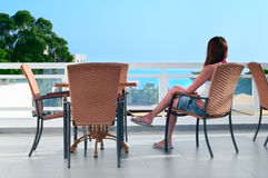 Beautiful woman sitting in balcony Stock Images