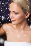 Beautiful woman sitting in bath towel at sauna Stock Image