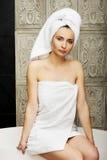 Beautiful woman sitting on bathtub. Royalty Free Stock Photos
