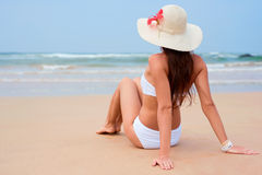 Beautiful woman sitting at the beach Royalty Free Stock Photo