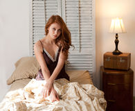 Beautiful Woman Sitting in Bed Stock Photos