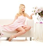 Beautiful woman sitting on bed in the morning Stock Image