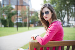 Beautiful woman sitting on bench Royalty Free Stock Photography