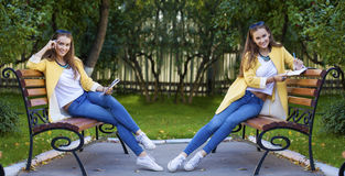 Beautiful woman sitting on a bench in autumn park Royalty Free Stock Image