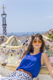 Beautiful woman sitting on a bench in a Park Guel,Barcelona,Spain Royalty Free Stock Image