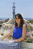 Beautiful woman sitting on a bench in a Park Guel,Barcelona,Spain Royalty Free Stock Photos