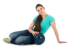 Beautiful woman sitting with a bowling ball, isolated on white Stock Photos