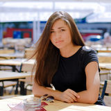 Beautiful woman sitting at cafe table & sunglasses Stock Photos