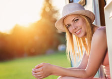 Beautiful woman sitting in a camper van Stock Images