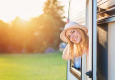 Beautiful woman sitting in a camper van Stock Image