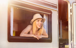 Beautiful woman sitting in a camper van Stock Photos