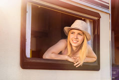 Beautiful woman sitting in a camper van Stock Photo