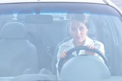 Beautiful woman is sitting in car Royalty Free Stock Photography