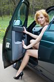 A beautiful woman is sitting in a car Stock Photo
