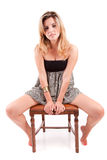 Beautiful woman sitting on a chair Royalty Free Stock Photo