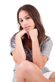 Beautiful woman sitting on a chair. Isolated Royalty Free Stock Images