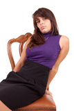 Beautiful woman sitting on a chair Stock Images