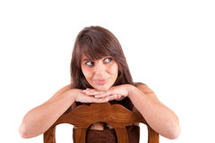 Beautiful woman sitting on a chair Stock Image