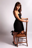 Beautiful woman sitting on a chair Royalty Free Stock Images