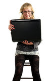 Beautiful woman sitting in the chair with laptop Royalty Free Stock Photos