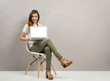 Woman showing her work Stock Images