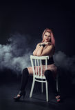 Beautiful woman sitting on the chair Royalty Free Stock Photo