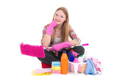 Beautiful woman sitting with cleaning equipment isolated on whit Royalty Free Stock Photography