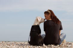 Beautiful woman sitting with dog looking each othe Stock Photo