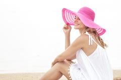 Beautiful woman sitting while enjoying beach view Royalty Free Stock Images