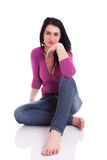 Beautiful woman, sitting on the floor Royalty Free Stock Photos