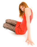 Beautiful woman sitting on the floor Stock Photo