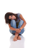 Beautiful woman, sitting on the floor Royalty Free Stock Photography