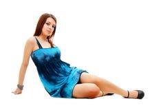 Beautiful woman sitting on the floor Stock Image