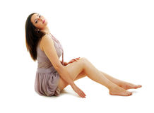 Beautiful woman sitting on the floor Royalty Free Stock Images