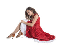Beautiful woman sitting on the floor Stock Images