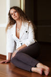Beautiful woman sitting on the floor. At apartment Royalty Free Stock Photo