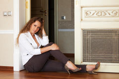 Beautiful woman sitting on the floor. At apartment Royalty Free Stock Photos