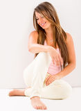 Beautiful woman sitting on the floor Stock Photo