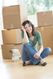 Happy Woman Sitting On Floor In New House Stock Photo