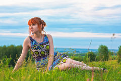 Beautiful woman sitting on the ground Stock Photo