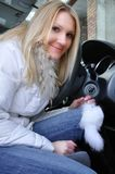 Beautiful woman sitting in her car. And holding keys Stock Photography