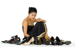 Beautiful woman sitting with her shoes Royalty Free Stock Image